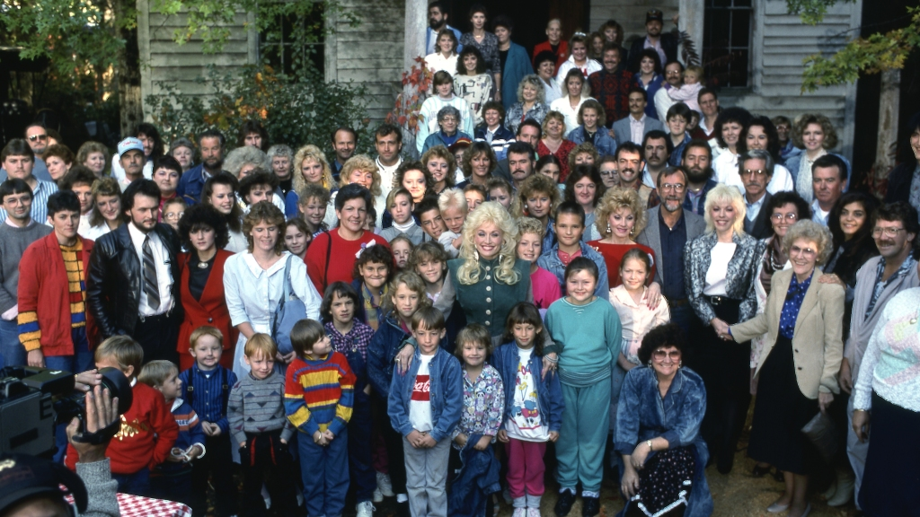 Group shot of Dolly Parton with family and crew on set of her 1987 TV special