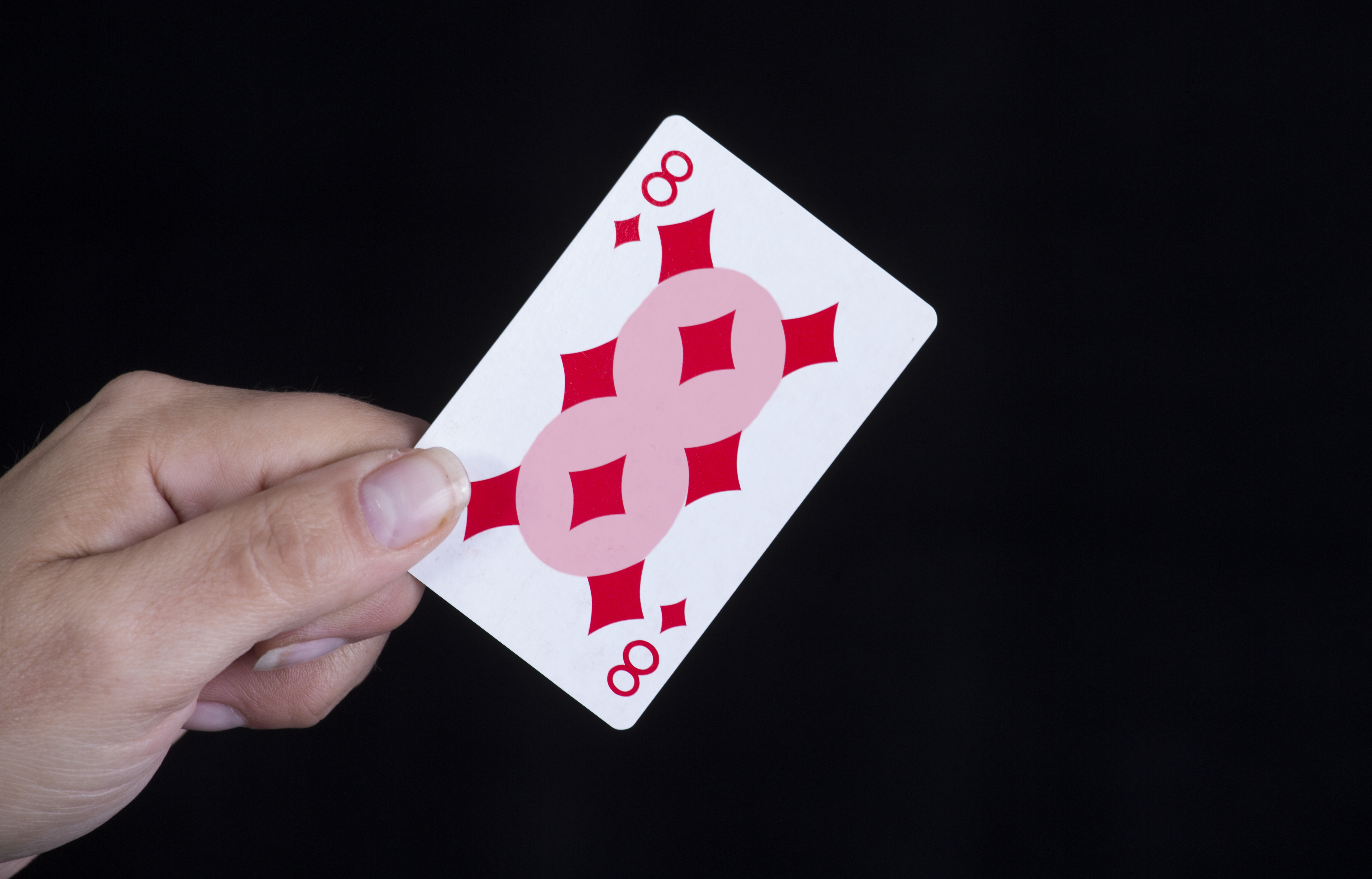 Highlighted figure 8 on 8 of diamonds card