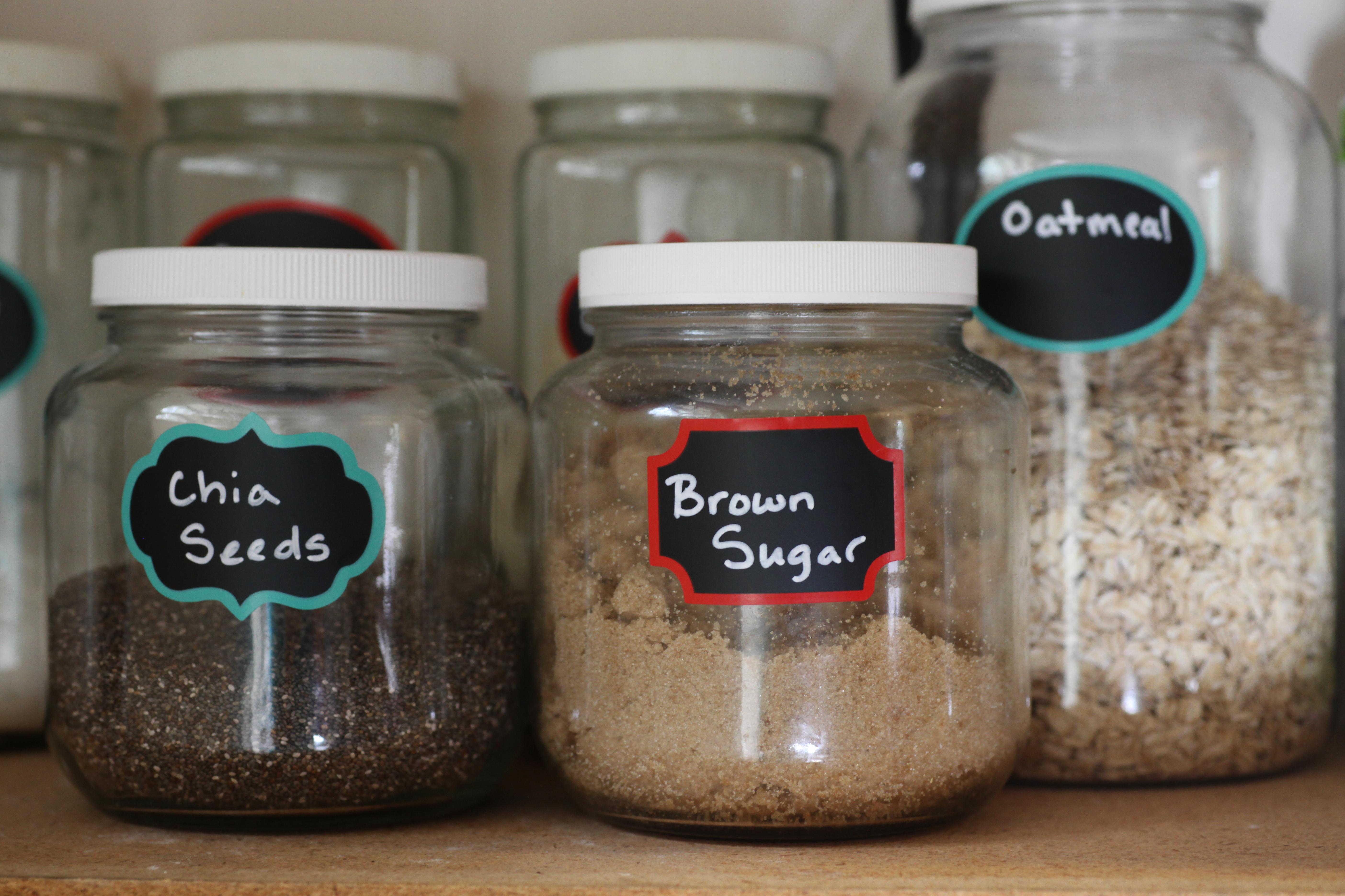 Labels on food jars in pantry.