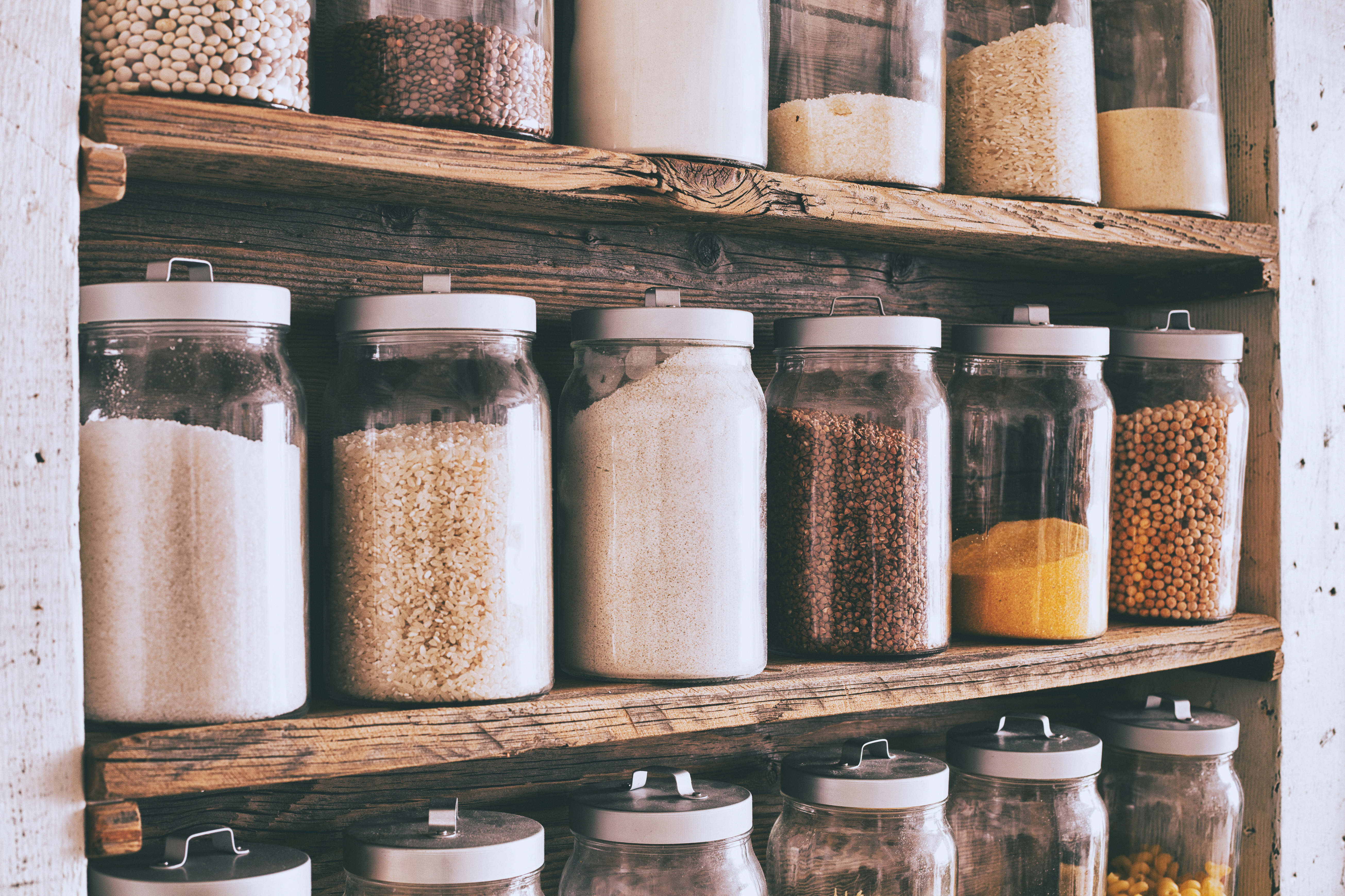 Dried beans and cereal stored in glass jars.
