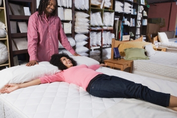 African couple shopping for beds