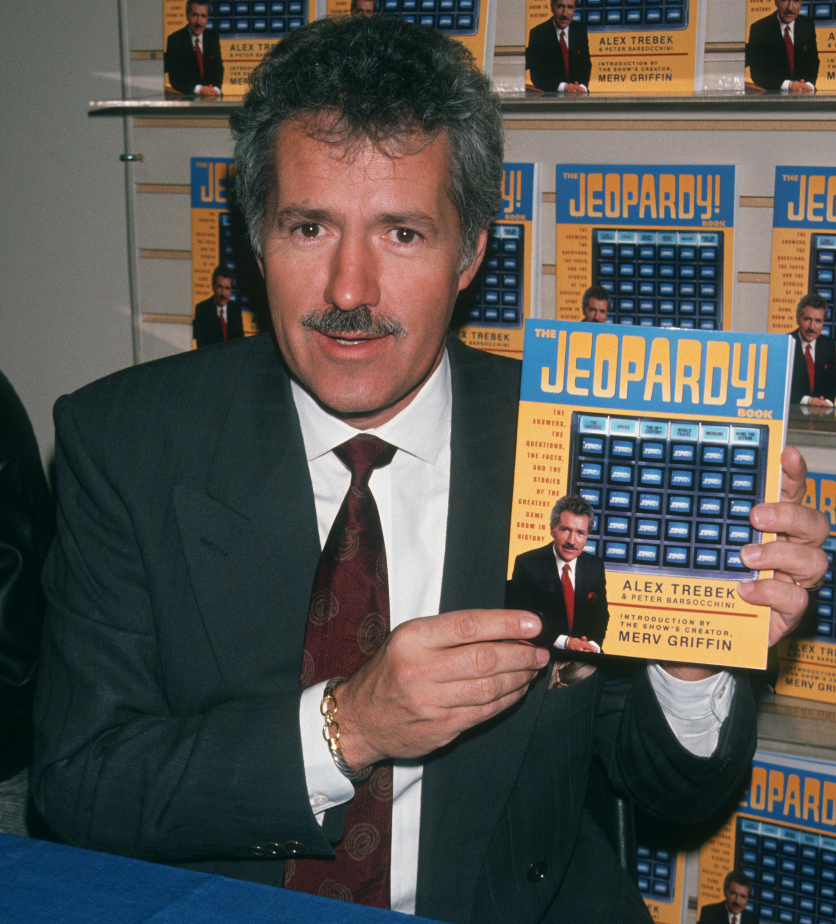 Alex Trebek with Jeopardy! book