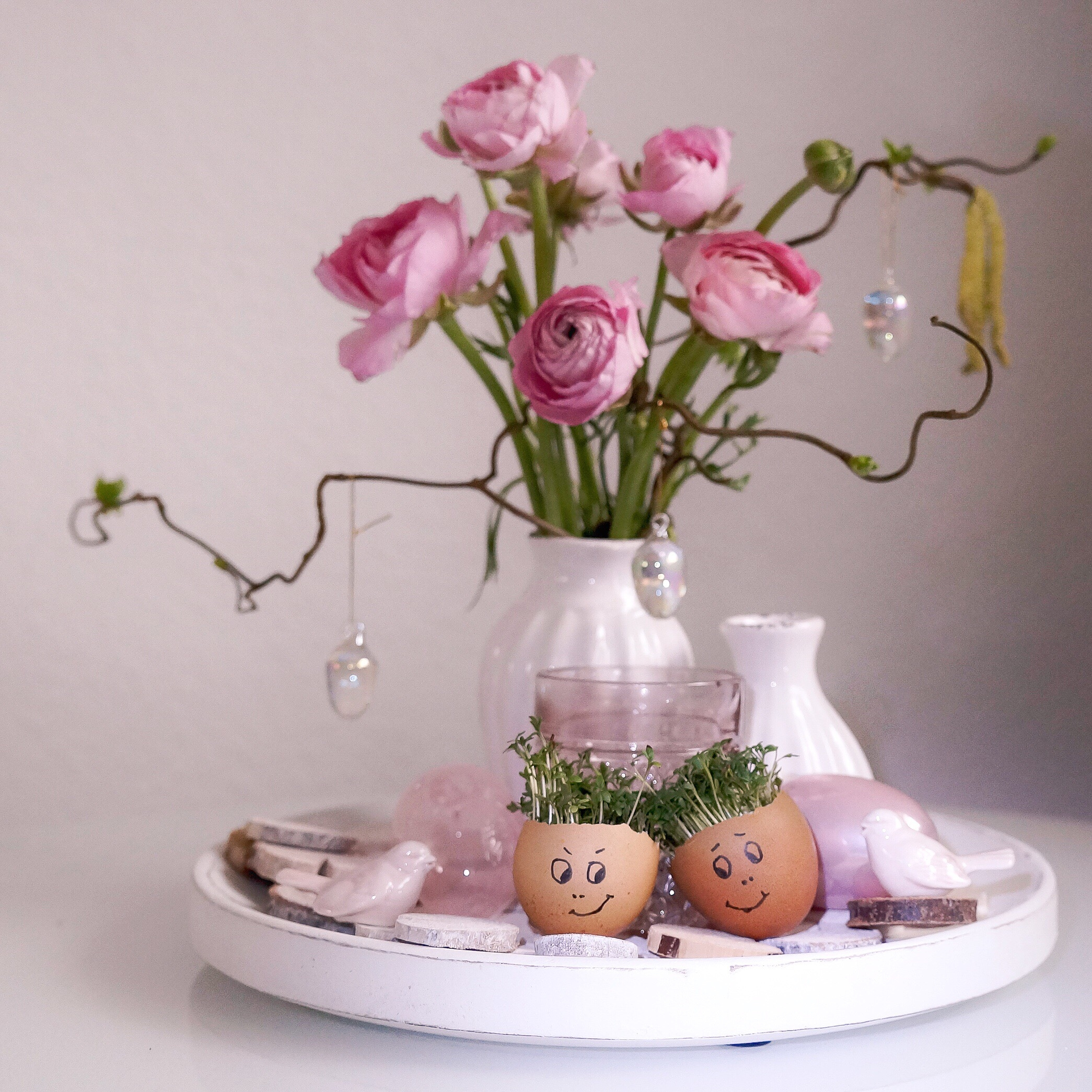 Easter eggs holding small flowers