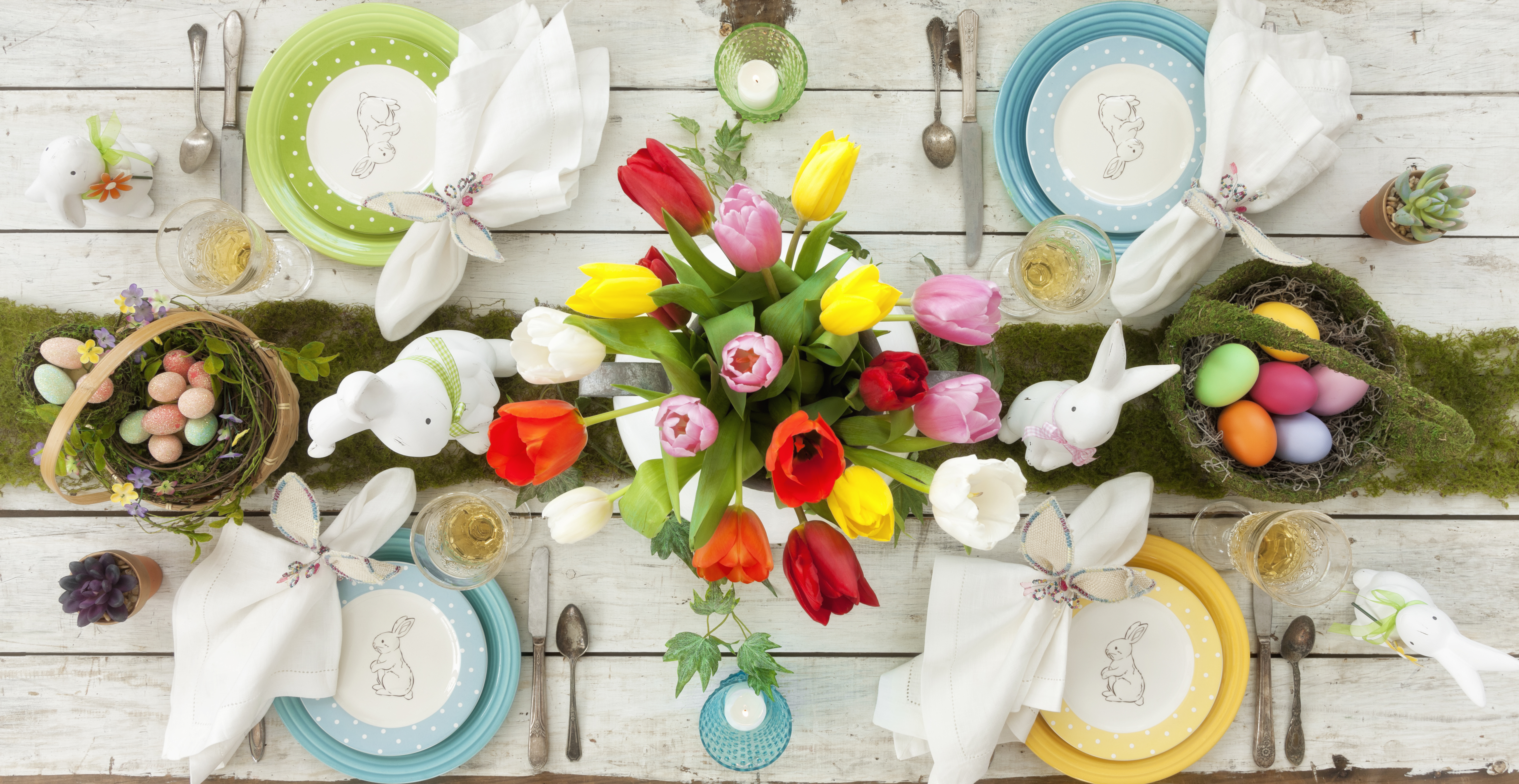 colorful easter table setting with bunny rabbit plates