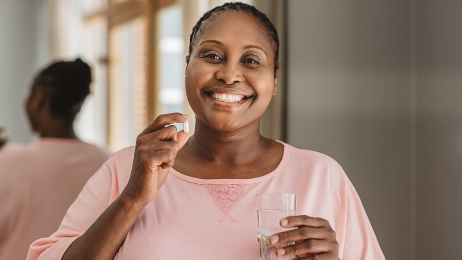 Black woman taking the best calcium supplement