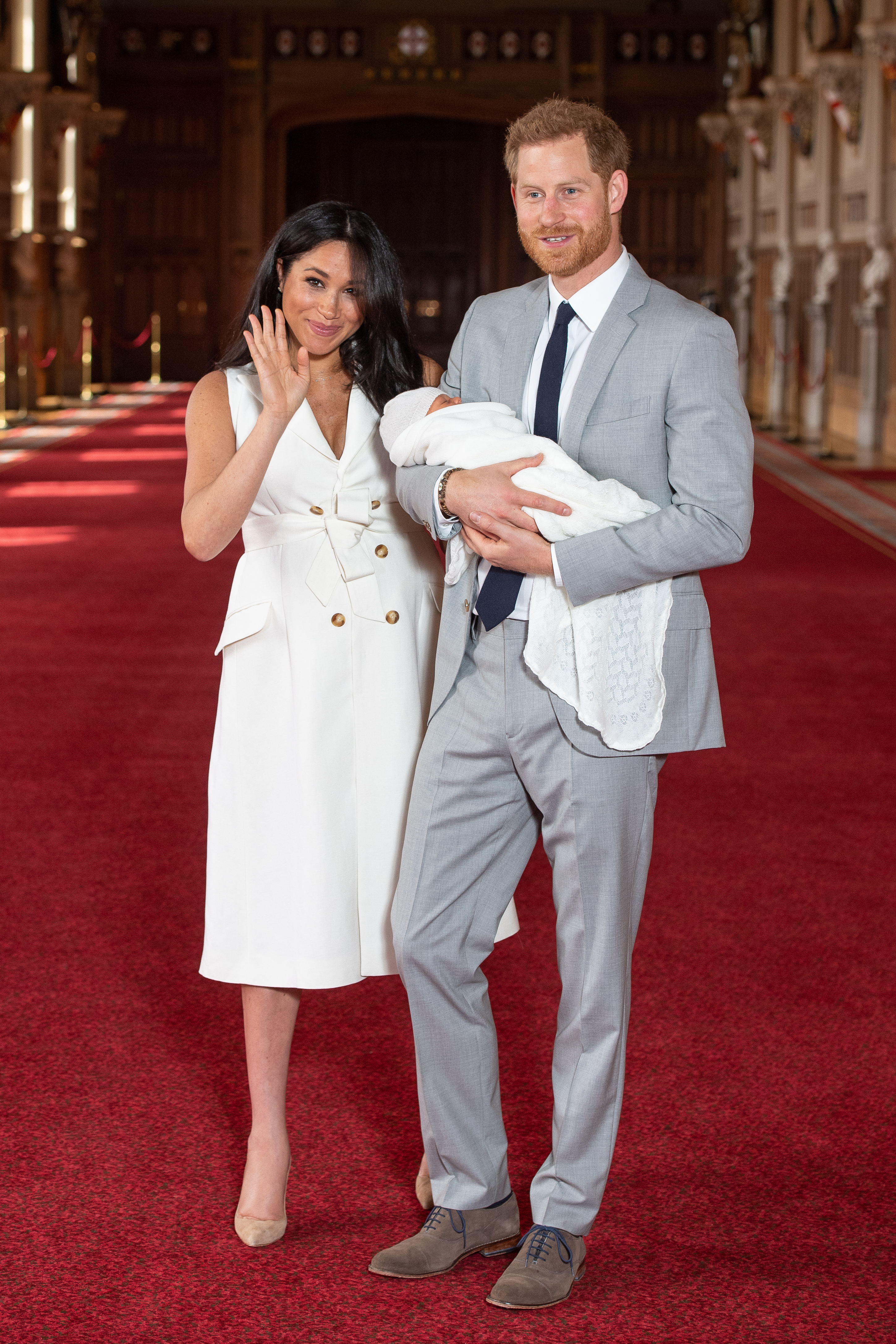 meghan markle, duchess of sussex, holding her son, prince archie, with husband prince harry, duke of sussex