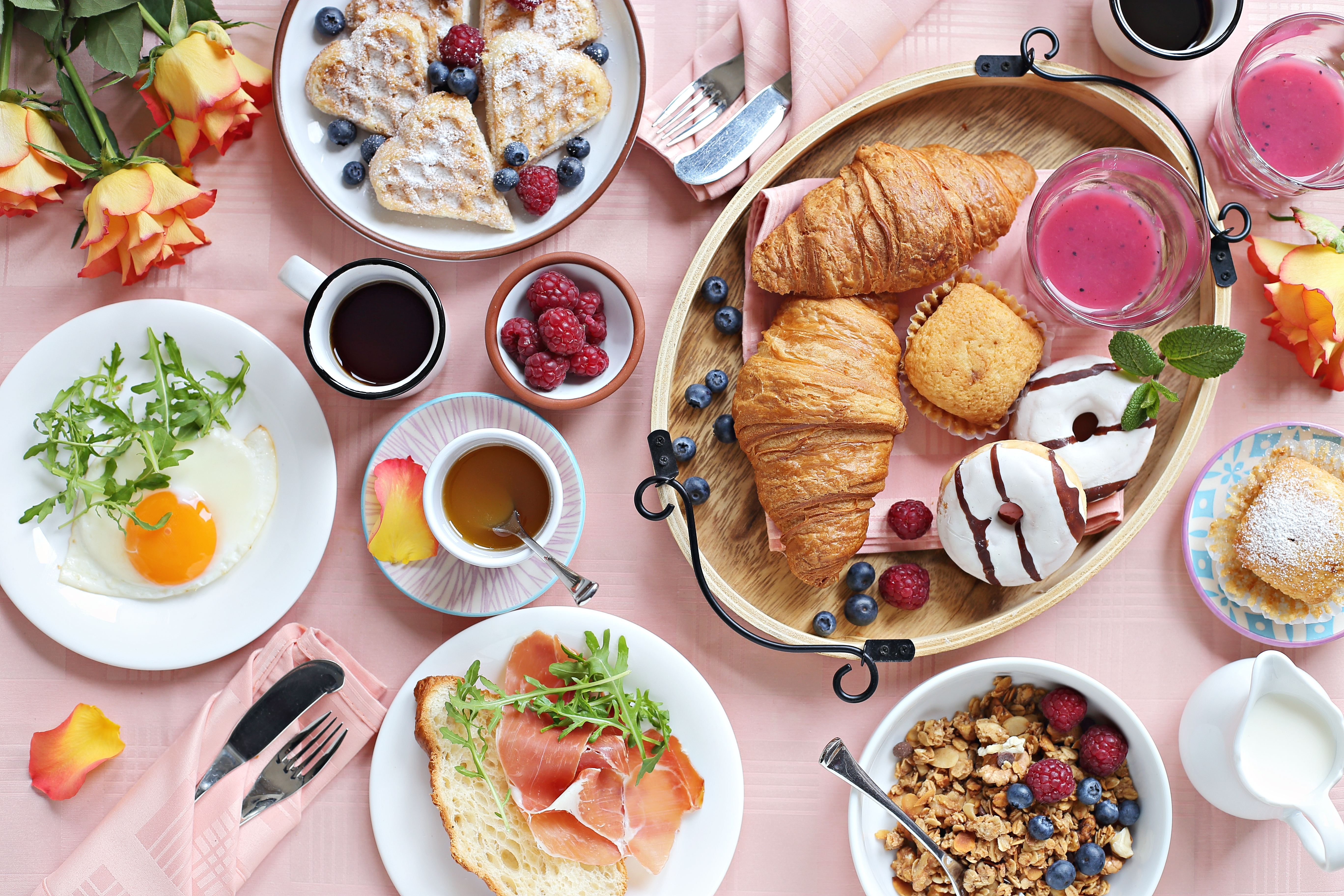 breakfasts foods on table with pink tablecloth