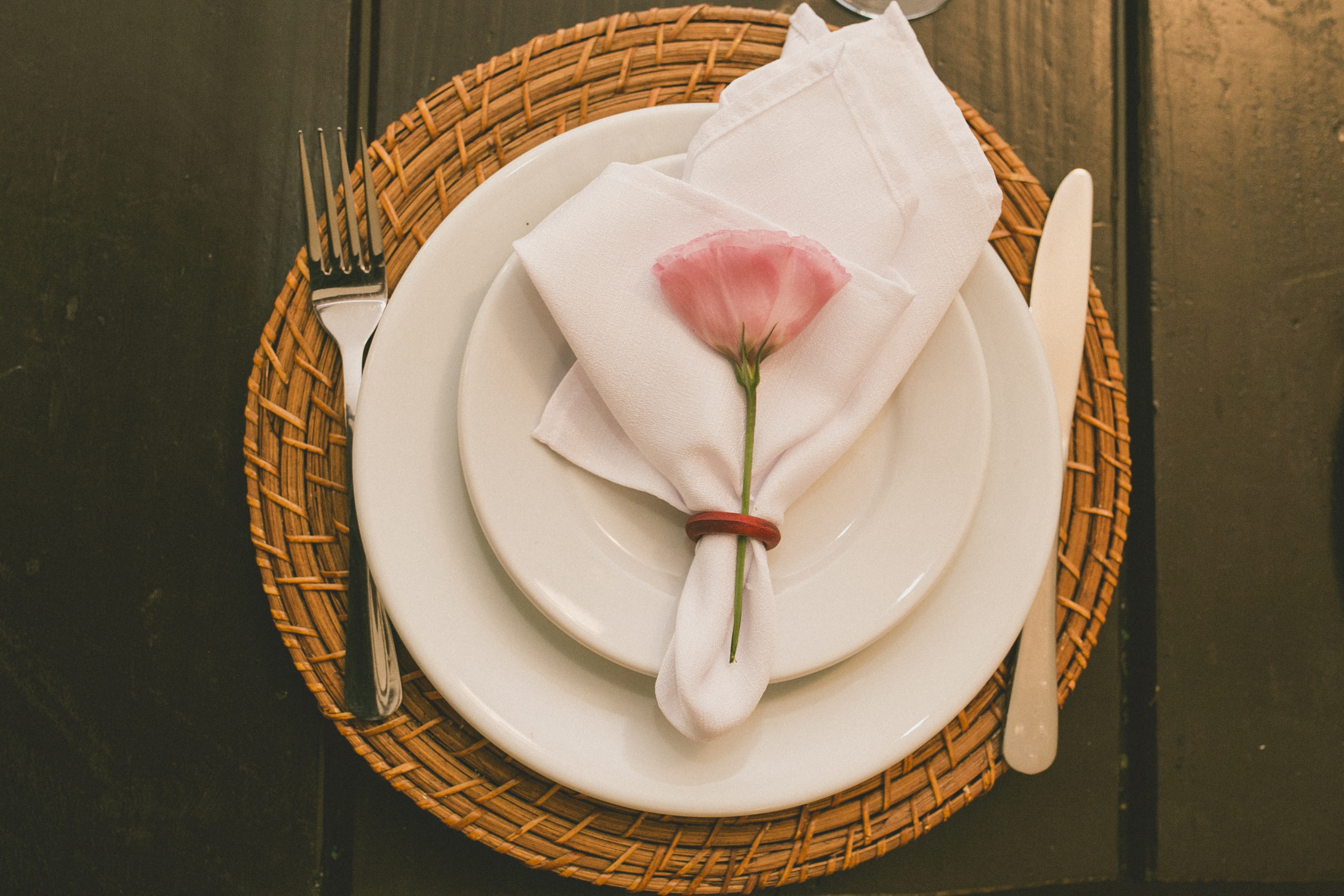 elegant place setting with cone napkin and rose