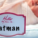 "Newborn in hospital bed with name tag reading ""Hello, my name is... Batman"""