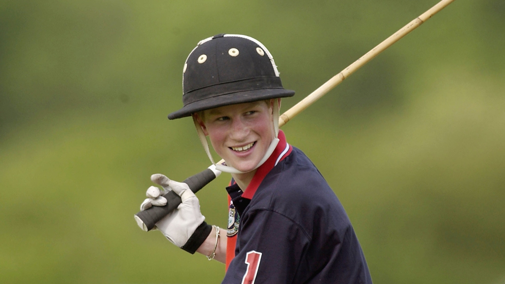 Teen Prince Harry playing polo