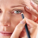 woman applying eyeliner