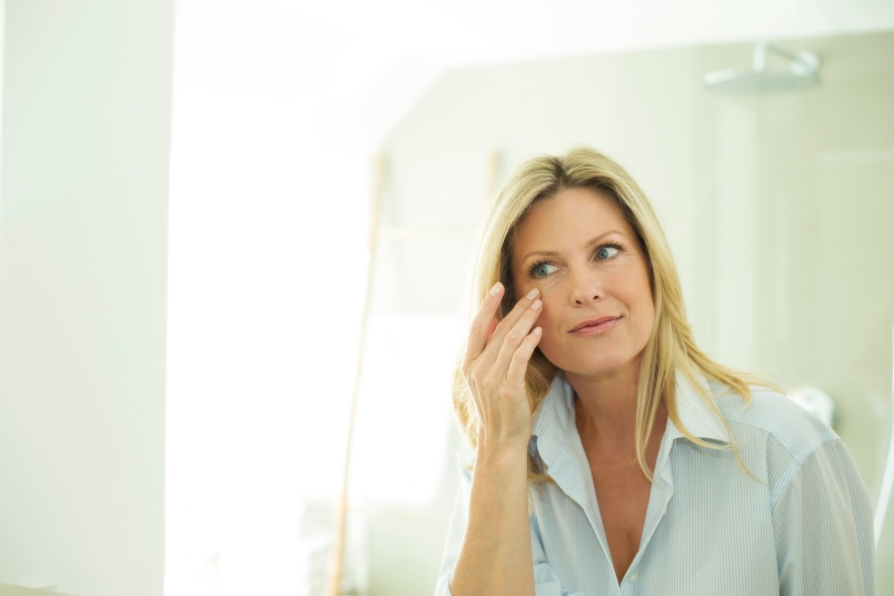 Portrait of woman looking at her mirror image in the morning