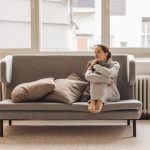 Woman sitting on couch looking sideways