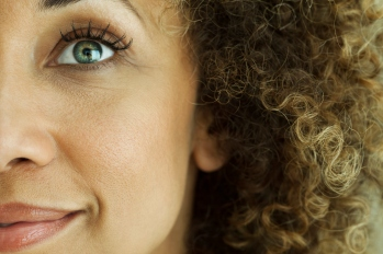 close up of woman's eye and curly hair