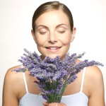 women sniffing bouquet of lavender plants