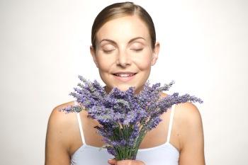 women sniffing bouquet of lavender plants
