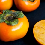Persimmons with black background