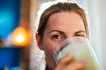 Woman enjoying fresh smoothie.