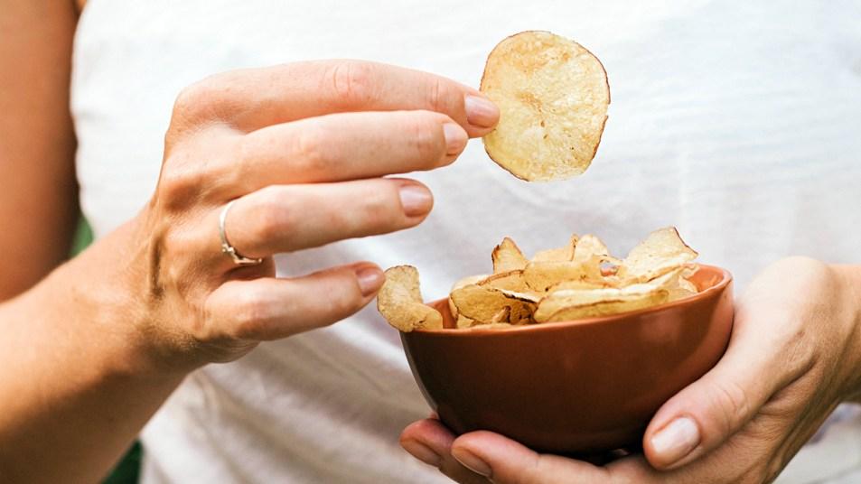 Woman holding potato chips