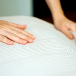 Hands smoothing bed sheets