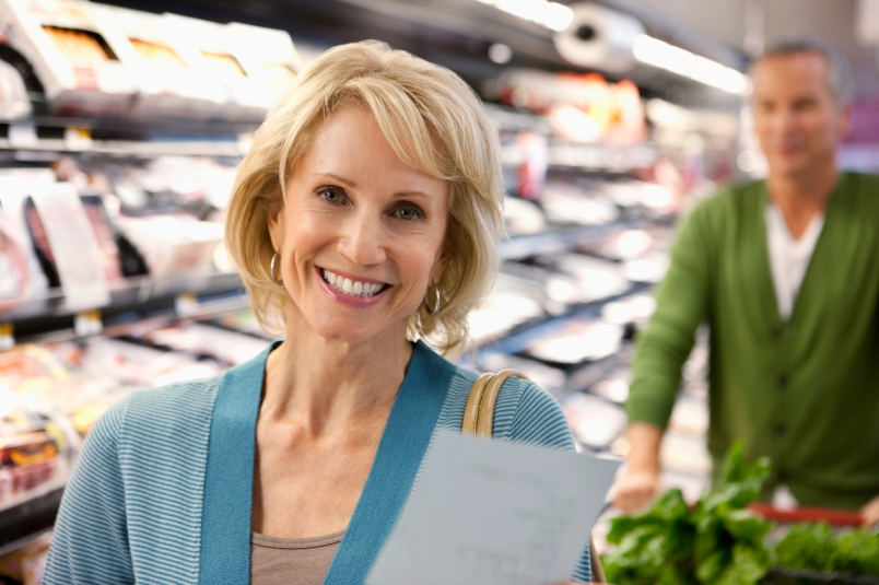 older couple social distancing grocery shopping