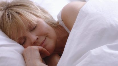 mature woman asleep in bed