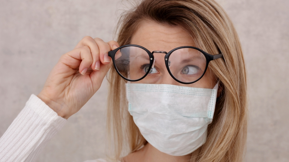 Woman wearing glasses and a face mask