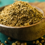 Coriander in wooden spoon