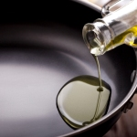 Pouring oil in a pan