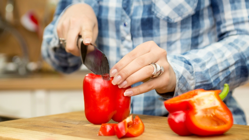 Woman's hands slicing a red pepper