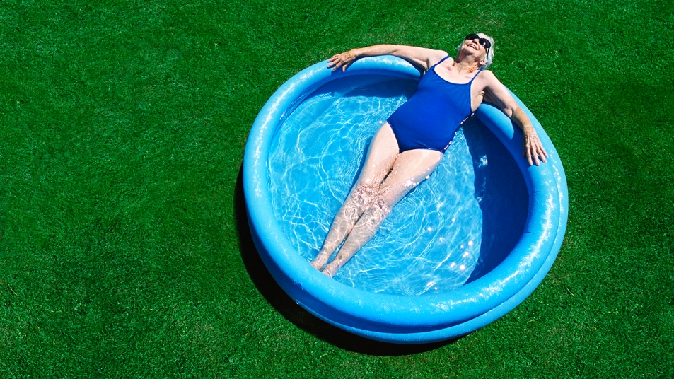 woman lounging in an inflatable pool