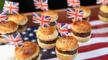 Mini burgers with British flags on an American flag