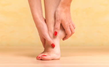 Massaging sore foot