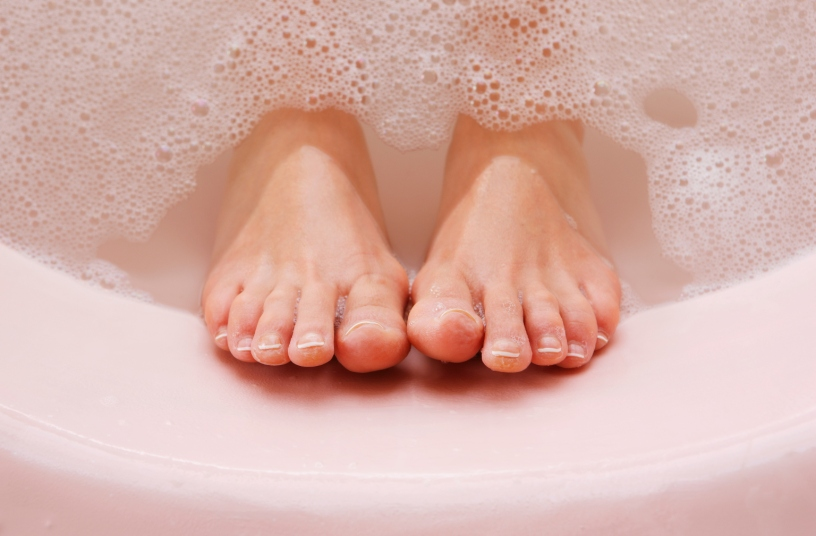 feet soaking in a bath