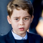 Close up of Prince George looking grumpy