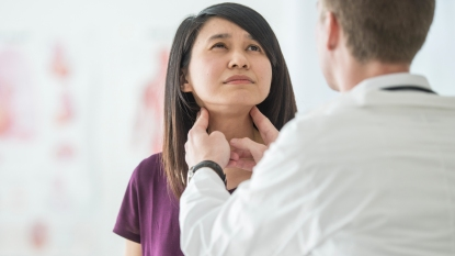 Doctor checking thyroid