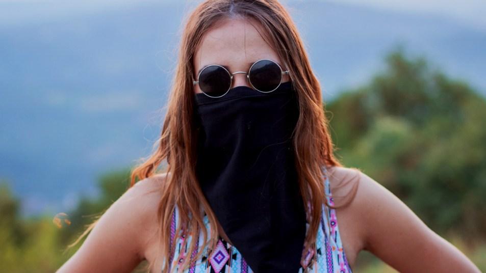 Woman wearing gaiter neck mask