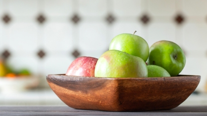 Wooden bowl with red and green apples