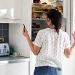 Woman looking inside fridge
