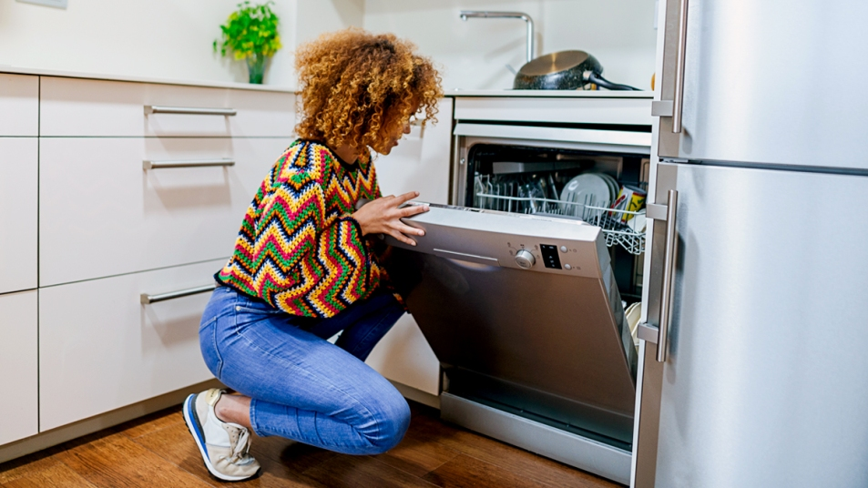 Woman looking in her dishwasher