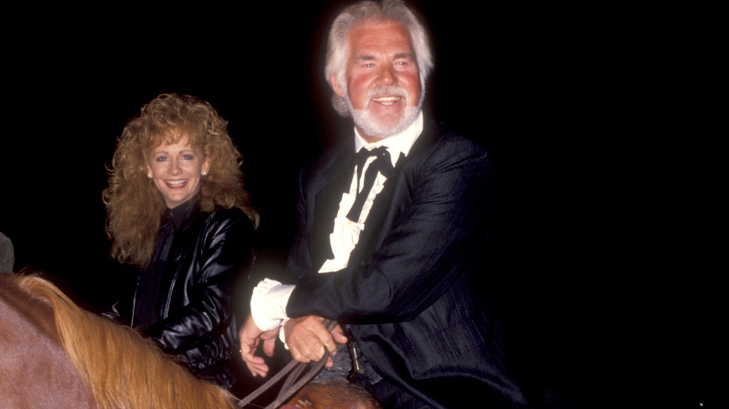 Kenny Rogers and Reba McEntire on horseback