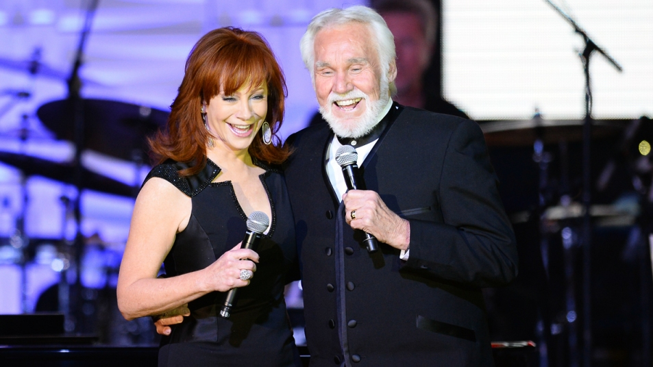 Reba McEntire and Kenny Rogers on stage