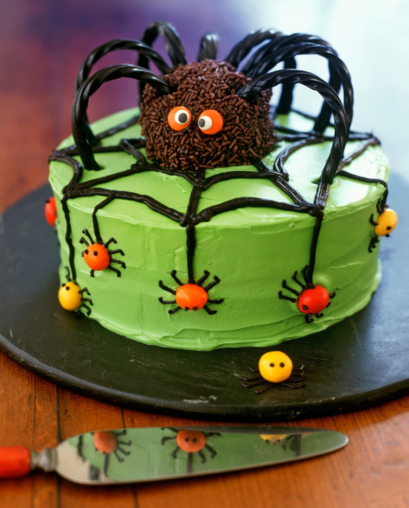 Green cake with spider decoration