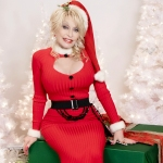 Dolly Parton surrounded by Christmas decorations