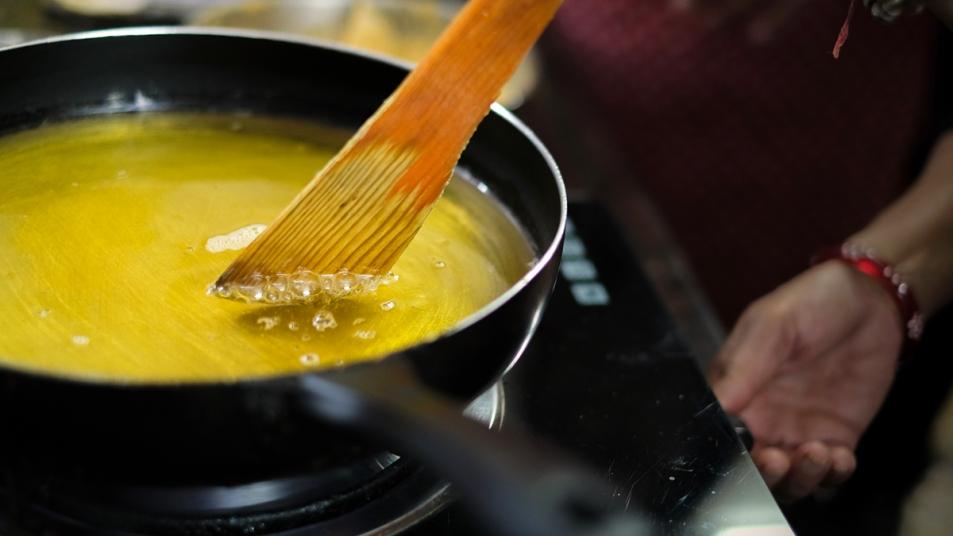 Wooden spoon in hot oil