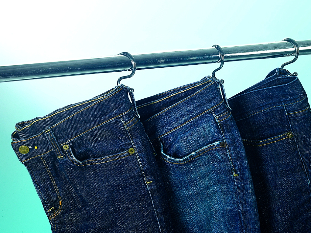 Jeans hanging on s hooks