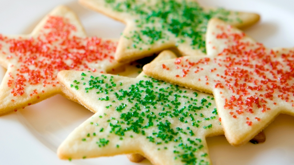 Star-shaped sugar cookies with red and green sprinkles