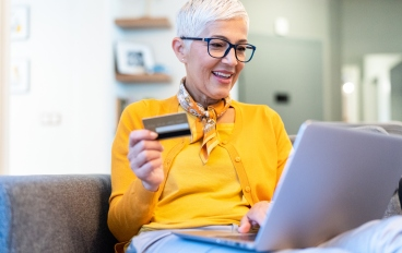 Woman Online shopping with a credit card