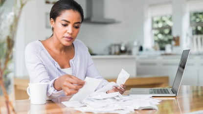 Woman Sorting Paper Receipts