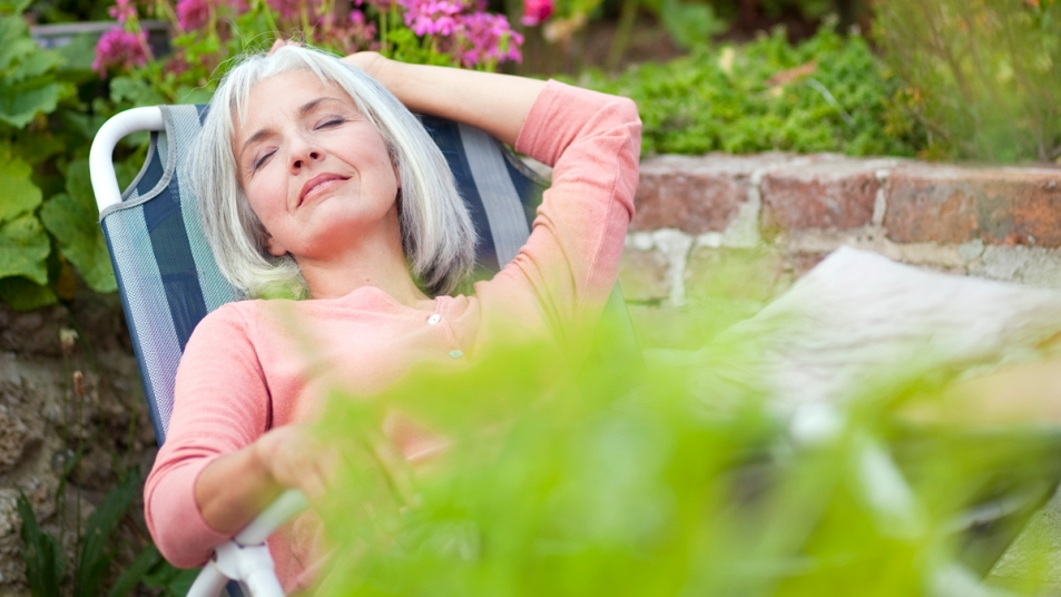 Woman napping on lawn chair